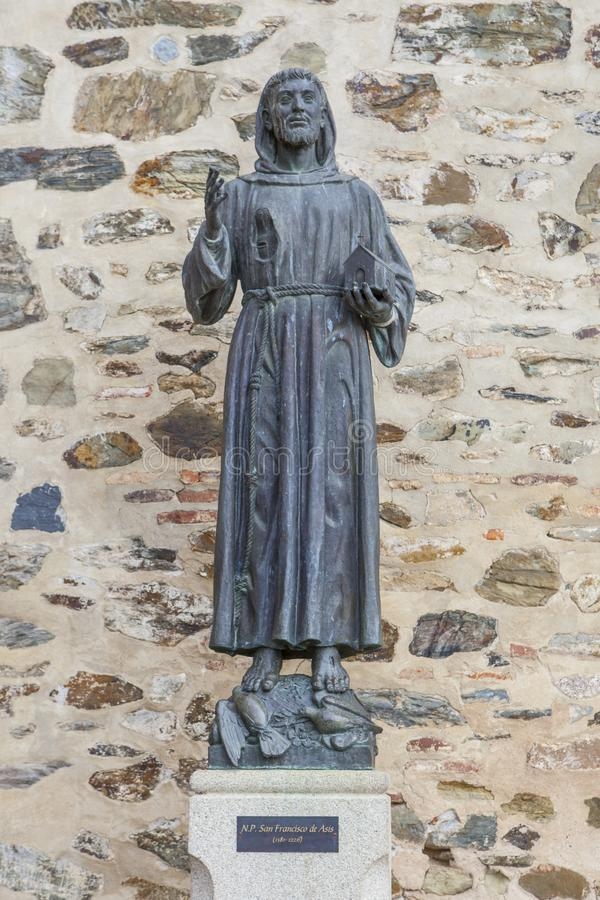 Francis of Assisi bronze statue at Guadalupe Monastery entry royalty free stock image
