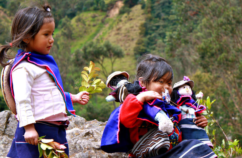 Guambiano girls with dolls, Colombia royalty free stock image