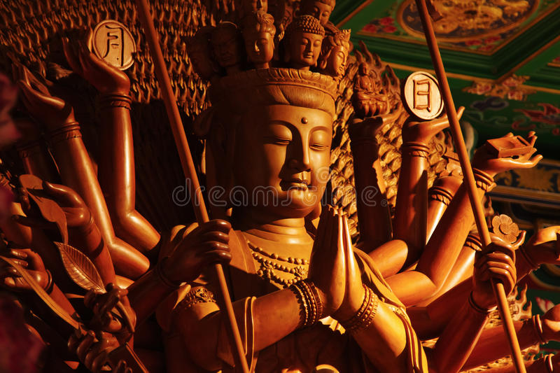 Guan Yin sculpture Thousand Hand carved of wood stock photo