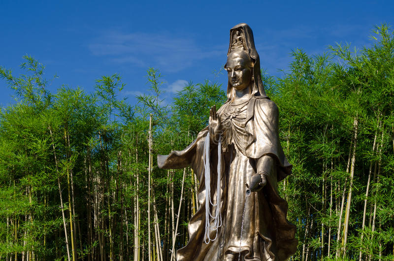 Download Guan Yin Statue In Bamboo Garden Stock Photo   Image: 55817359