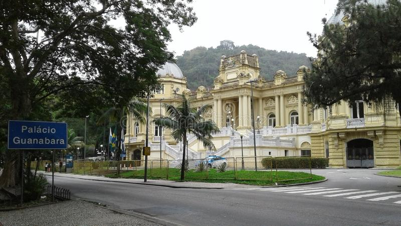 Guanabara Palace in Laranjeiras Rio de Janeiro Brazil. Guanabara in Laranjeiras Rio de Janeiro Brazil. Historic buildings, avenue, trees, cloudy sky, landscape royalty free stock images