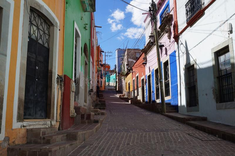 Guanajuato Mexico November 2017, colourful colonial street in the town`s center. Colonial street in the center of Guanajuato in Mexico. Empty street, colourful royalty free stock photos