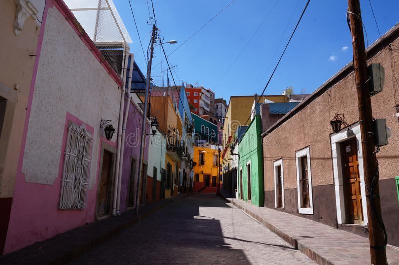 Guanajuato Mexico November 2017, colourful colonial street in the town`s center. Colonial street in the center of Guanajuato in Mexico. Empty street, colourful royalty free stock photo