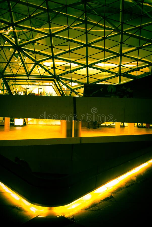 Guangdong Grand Theater at night 1. Night scene of Guangdong Grand Theater. Under the yellow fluorescent light, the appearance lines of the Grand Theater royalty free stock photography