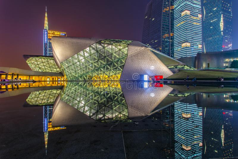 Guangzhou Opera House and reflection on the water at night landscape stock photo
