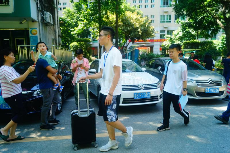 Guangzhou, China: on the first day of college, many freshmen arrive at the university campus. On the first day of college in guangzhou, many freshmen come to the stock photos