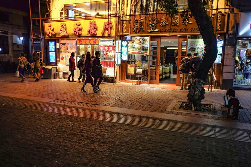 Unacquainted Chinese People walking in `beijing road ` the famous walking street in guangzhou city china stock images