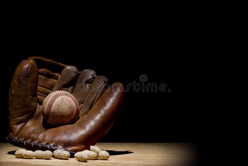 Guante y béisbol foto de archivo