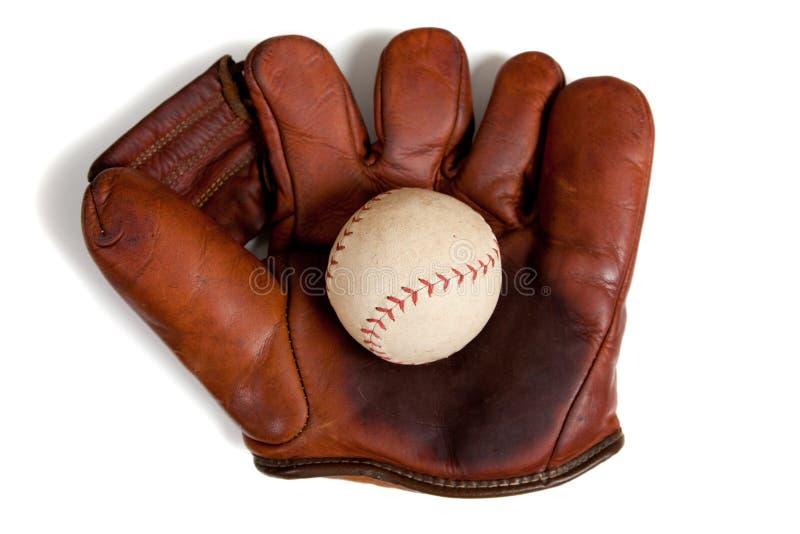 Guante y bola de cuero antiguos de béisbol fotografía de archivo