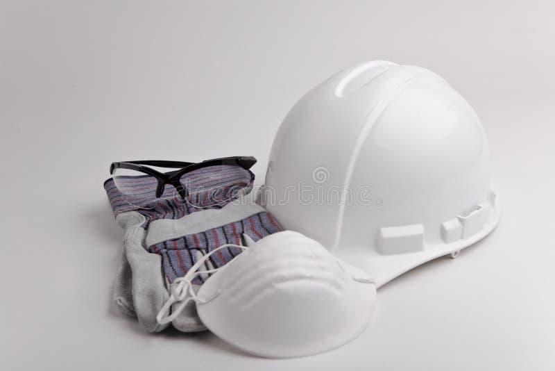 Guante y máscara de los vidrios del sombrero duro del equipo de seguridad fotos de archivo libres de regalías