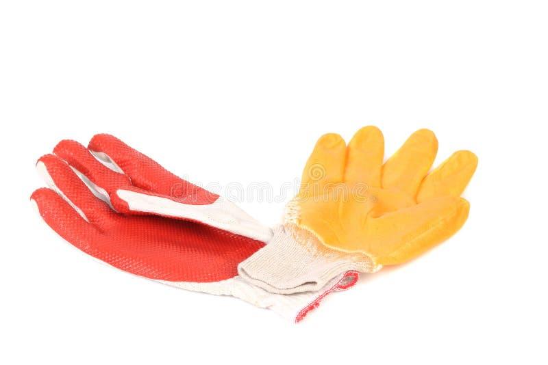 Guantes protectores rojos y amarillos. foto de archivo libre de regalías