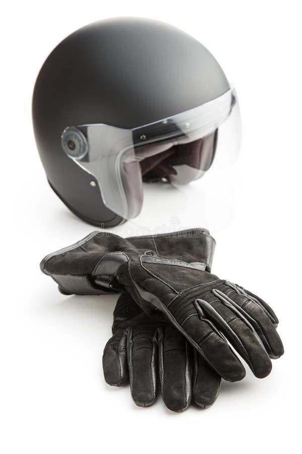 Guantes y casco de la motocicleta imagen de archivo