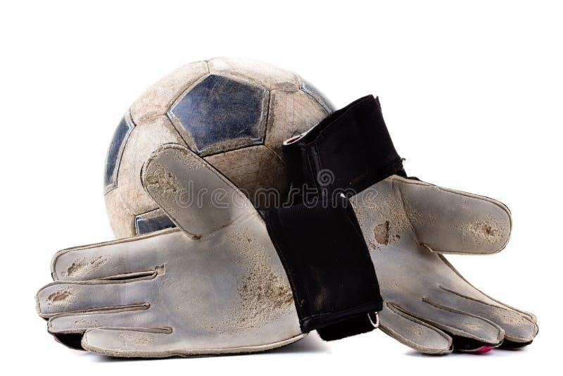 Guanti degli abiti sportivi e della partita di football americano del portiere della palla, vecchi immagini stock libere da diritti