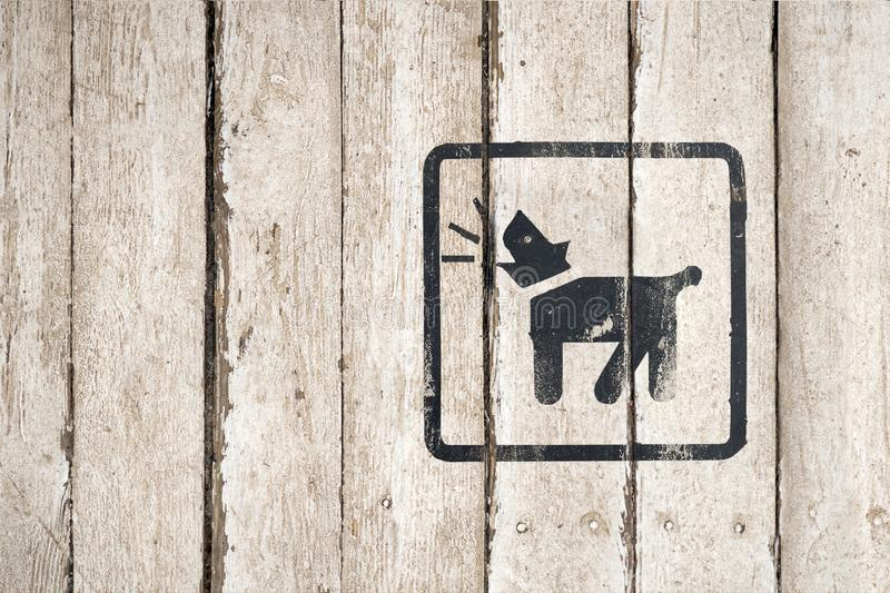 Guard dog inside icon. Part of a series. Dog Barking icon. Button image on wooden background. Dog Barking icon. Button stock images