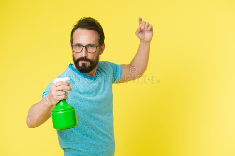 On guard of freshness. Refresh concept. Bearded man with eyeglasses refresh sprinkling water. Man refresh with spray stock photos