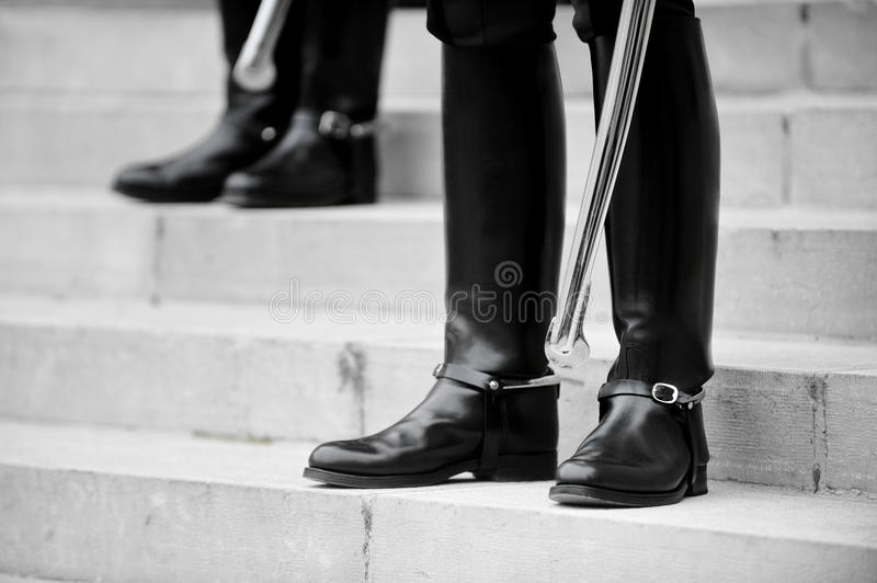 Guard of honour boots. Boots detail of ceremonial guards of honour standing on the stairs stock photo