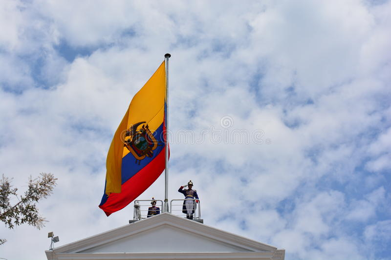 Guard over the presidential palace with the flag of Ecuador, in Quito. During the change of guards in Quito, Ecuador, a presidential guard sings the national stock image