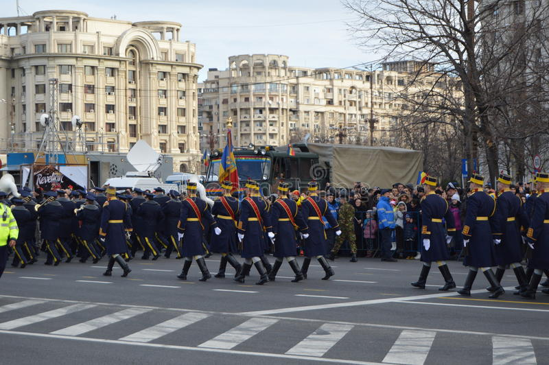 30 Guard Regiment. Bucharest, Romania, 01 December 2015 : Romanian's National Day parade. Military platoons , technical, police cars and planes royalty free stock image