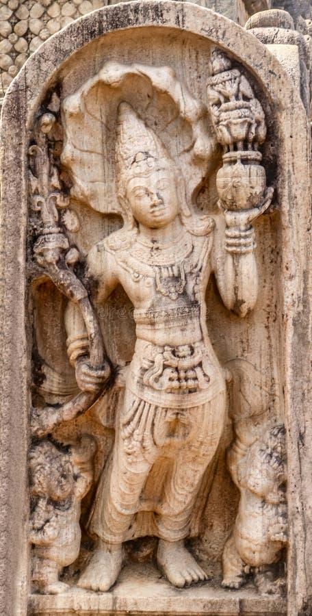 Guard stone. A guard stone from ancient ruins at polonnaruwa , srilanka royalty free stock photo