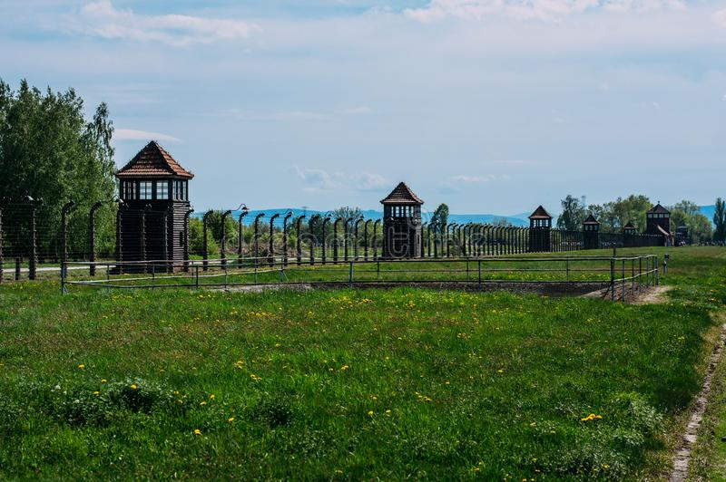 Guard towers of Auschwitz - Birkenau concentration camp royalty free stock photo