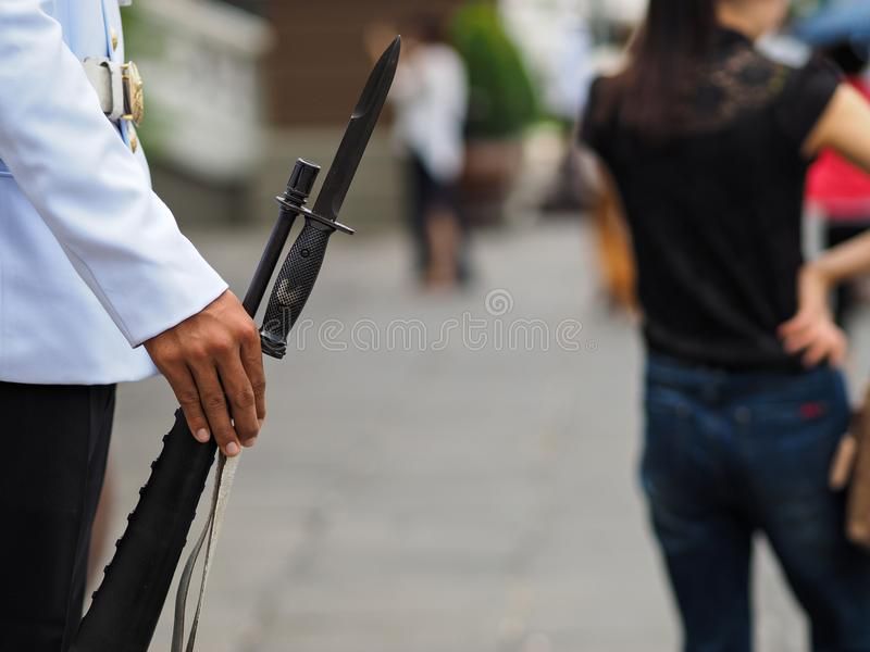 Guard with weapon. A guard with weapon in Bangkok royalty free stock images