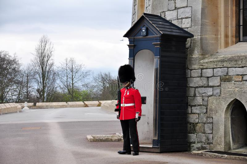 A guard wearing traditional bearskin standing to attention, UK royalty free stock images