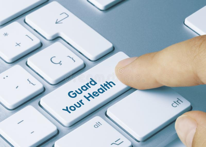 Guard Your Health - Inscription on White Keyboard Key royalty free stock images