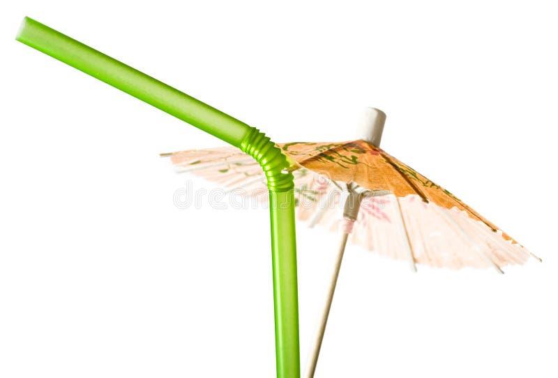 Guarda-chuva do cocktail e palha bebendo imagem de stock