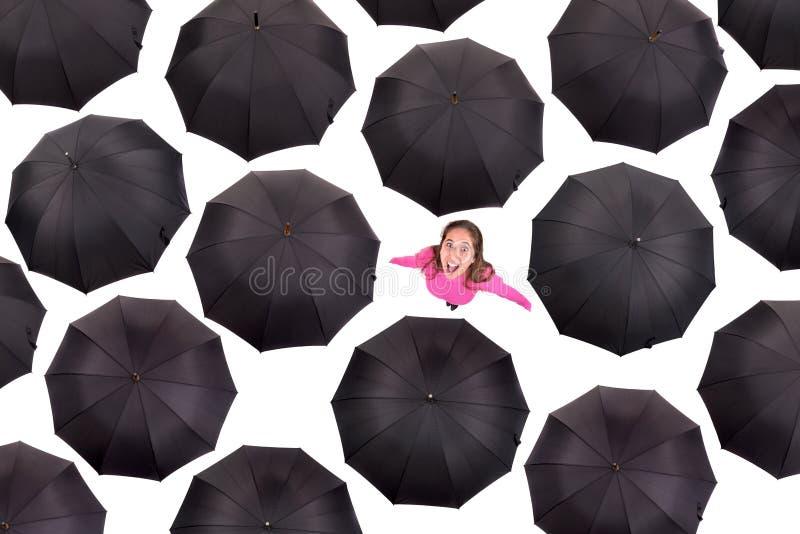 Guarda-chuvas do iamongst da menina imagens de stock royalty free