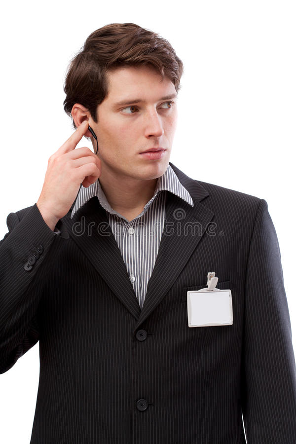 Guarda com tampão de ouvido e cartão da identificação fotografia de stock royalty free