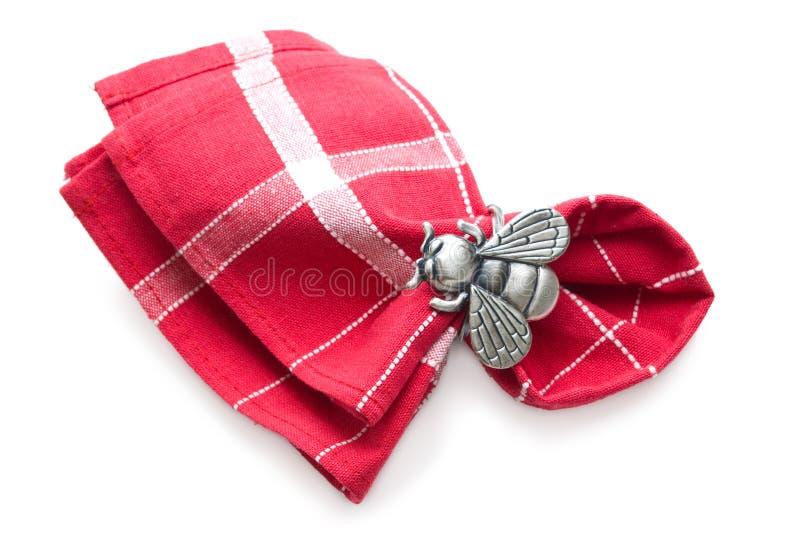 Guardanapo com um anel sob a forma de uma mosca. imagem de stock royalty free