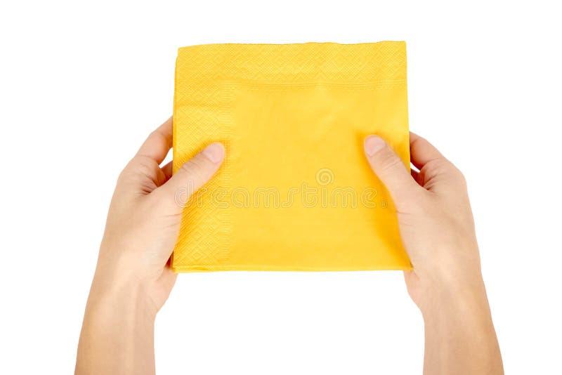 Guardanapo de papel amarelo para o alimento à disposição isolado no fundo branco Objeto do serviço da cozinha foto de stock royalty free