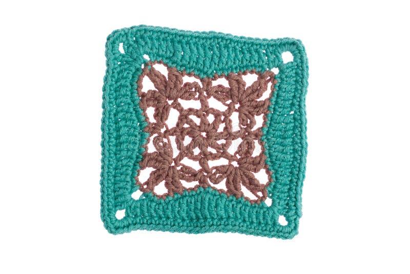 Guardanapo decorativo feito ? m?o, feito croch? com linhas coloridas imagens de stock