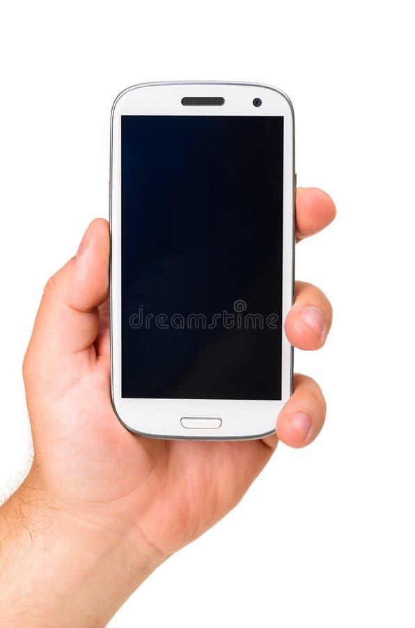 Guardando um telefone de tela táctil moderno imagem de stock royalty free