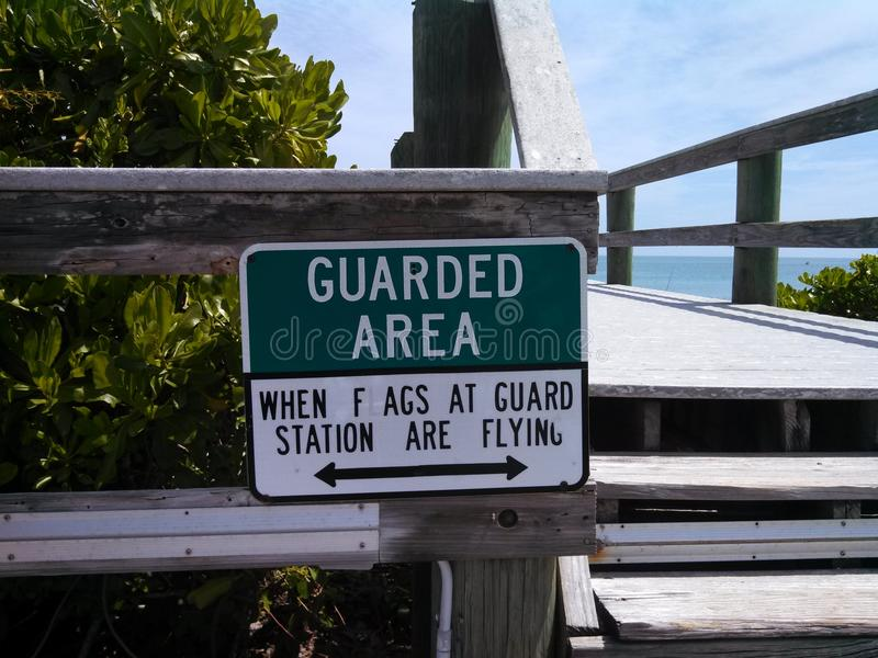 Guarded Area. Mistake found on boardwalk sign stock photography