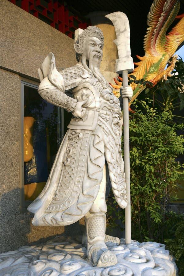 Guardião de pedra do templo no parque da cidade de Hat Yai, Tailândia fotografia de stock royalty free