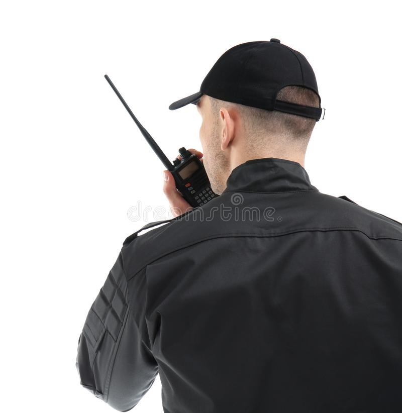 Guardia de seguridad masculino usando transmisor de la radio portátil fotos de archivo