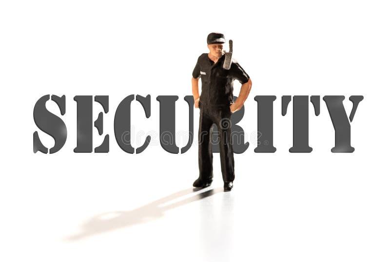 Guardia de seguridad miniatura con de servicio de radio fotografía de archivo