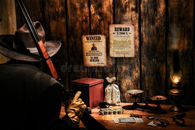 Guardia giurata ad ovest americana dell'ufficio del libro paga di leggenda fotografie stock