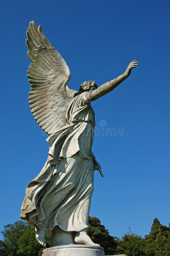Free Guardian Angel In Garden Stock Photography - 7042832