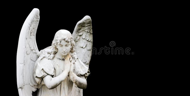 Guardian angel sculpture with open wings  on wide panorama banner black background with empty text space. Angel sad. royalty free stock image
