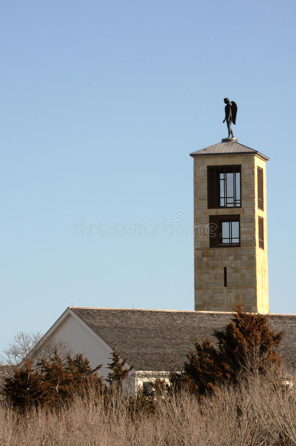 Guardian Angel. A guardian angel watching over a building high atop a tower in Cape Cod, Massachusetts royalty free stock photos