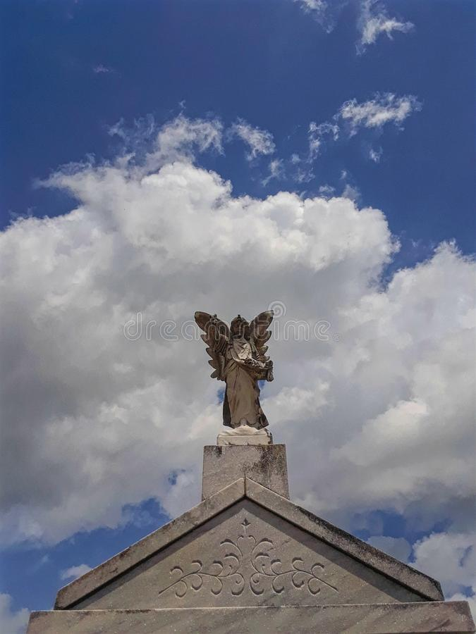 Guardian of the dead. Angel statue on a headstone royalty free stock photo