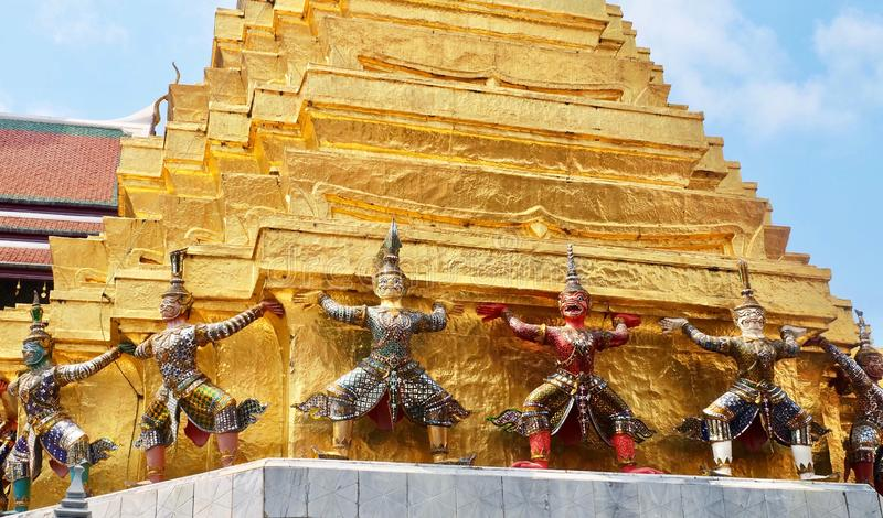 Guardian Giant Around Pagoda in Wat Phra Kaew Thailand. Demon Guardian Giant Statues Stand Around Pagoda and Liftting The Base of The Golden Pagoda at Wat Phra stock photography