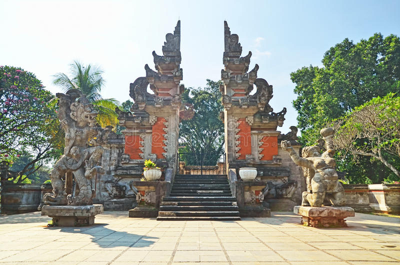 Guardian gods in front of Kori Agung (Balinese gate). Indonesia stock photo
