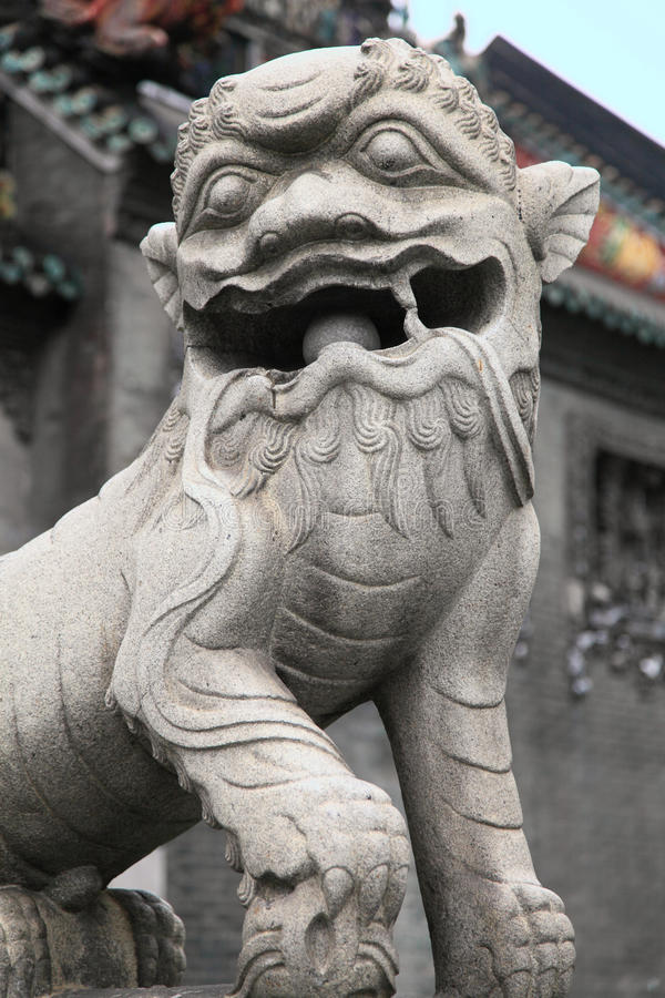 Guardian lion of the Chen Clan Ancestral Hall. Chinese guardian lion of the Chen Clan Ancestral Hall of Guangzhou, landmark architecture in China royalty free stock images