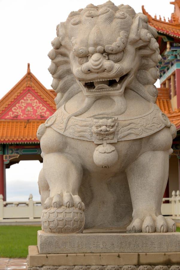Guardian Lion. Male Buddhist guardian lion ShiShi Nan Hua Temple Bronkhorstspruit near Pretoria stock photo
