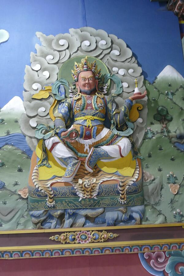 Guardian Lord deity sculpture on entrance to the Trassichoe Dzong. THIMPHU, BHUTAN - DEC 10 2019 - Guardian Lord deity sculpture on entrance to the Trassichoe stock photography