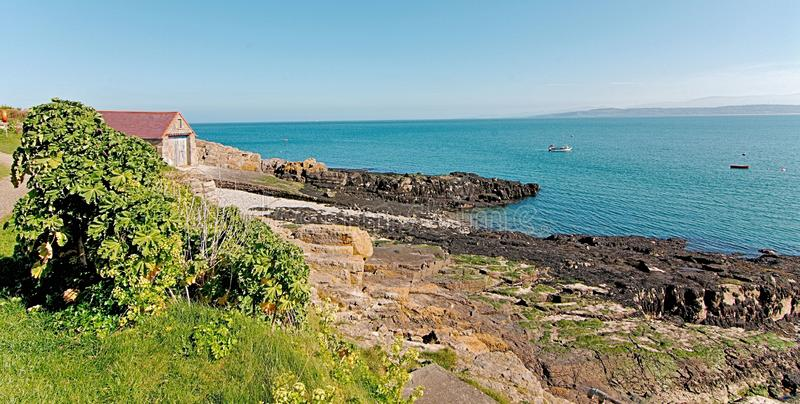 Guardian of The Seas - Moelfre Old Life Boat House and Slipway - Moelfre Isle of Anglesey North Wales. Moelfre Old Life Boat Station and slipway.  Still stand in royalty free stock photo