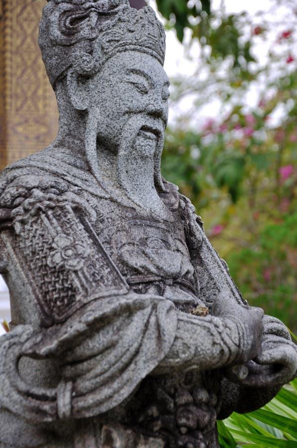 Guardiano di pietra a Wat Choumkhong fotografie stock